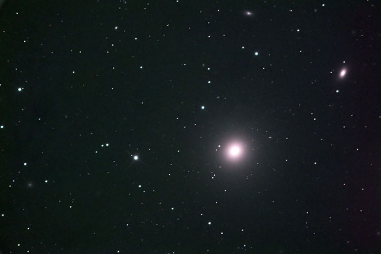 This is elliptical galaxy M84, member of the Virgo cluster