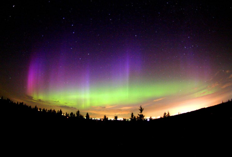 An Aurora - Charged Particles of Solar Wind Interact with the Ionosphere