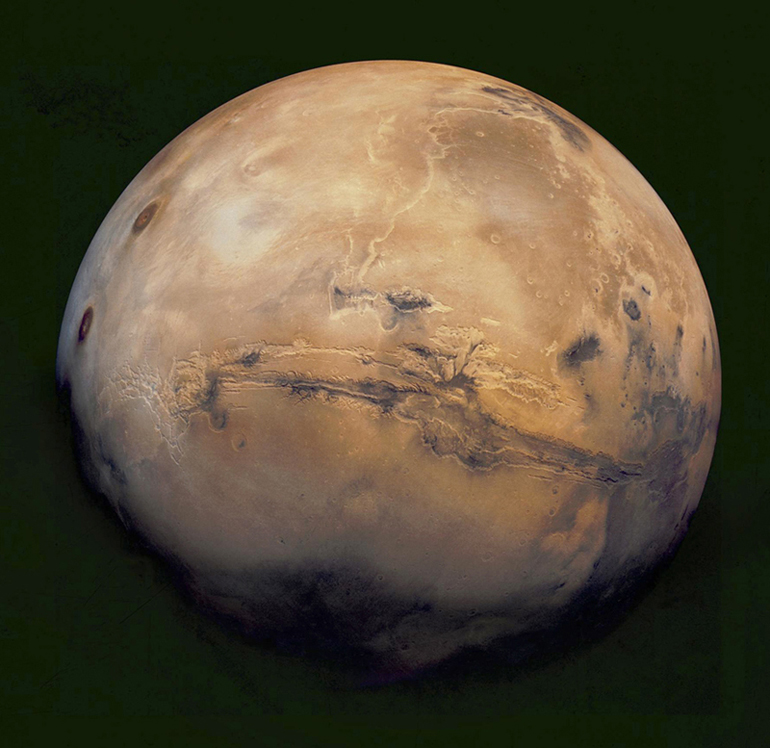 Global Mars from the Mariner orbiter. The Valles Marineris is the large feature